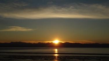 sunset_over_water_by_leroydaninja-d5e1w90